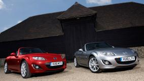 2010 Mazda MX-5 Miyako Red Vs Grey Front Pose